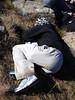 Samantha falls asleep in the sun on West Peak