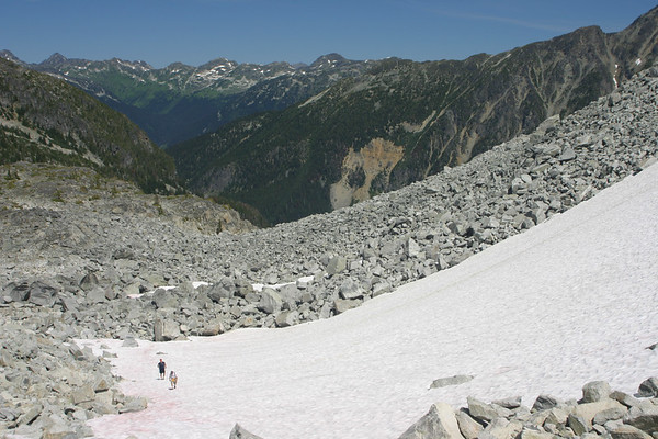 """Bob and Scott coming up the final snowfield just before making the saddle. In the distance is the Cayoosh Range. I'm hoping to do one final hike with the """"Phone Bill"""" team this Summer and the Cayoosh Range is a great candidate for that September hike."""