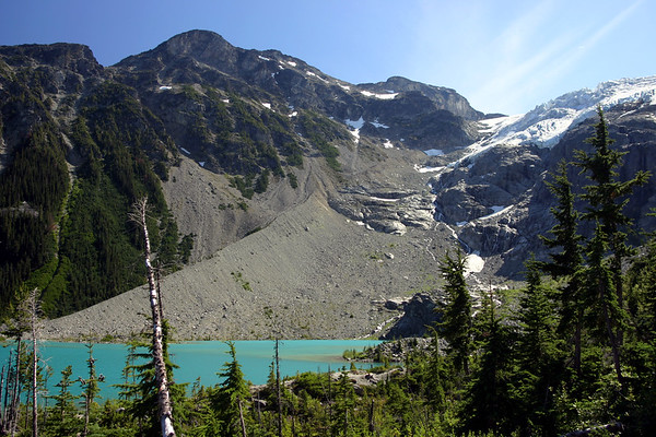 Upper Joffre Lake which is fed from above by the melting ice of the Matier Glacier. The Glacier pulverizes the rock into flour, which is then carried into the lake giving it the glacial blue color.