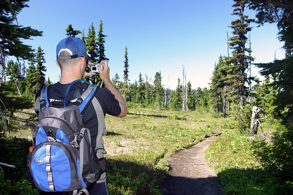 Cowden's first time to Garibaldi Provincial Park. Here he's taking a picture of a dead tree.