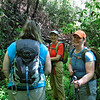 Pamela (camera shy), Brenda and Renee take a break along the re-purposed logging road---- recently used as a fire-brake as last summer's forest fire ravaged this area----now used as a trail into the high elevations of the Coleman River.