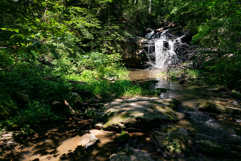 As the creek makes a sharp bend to the right, you will come to the waterfall.