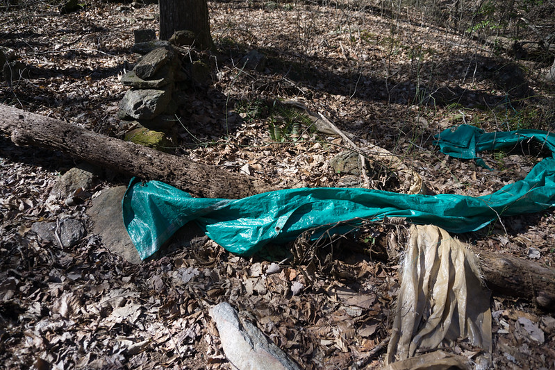 There are remnants of a substantial camp site near the bottom of the waterfall.