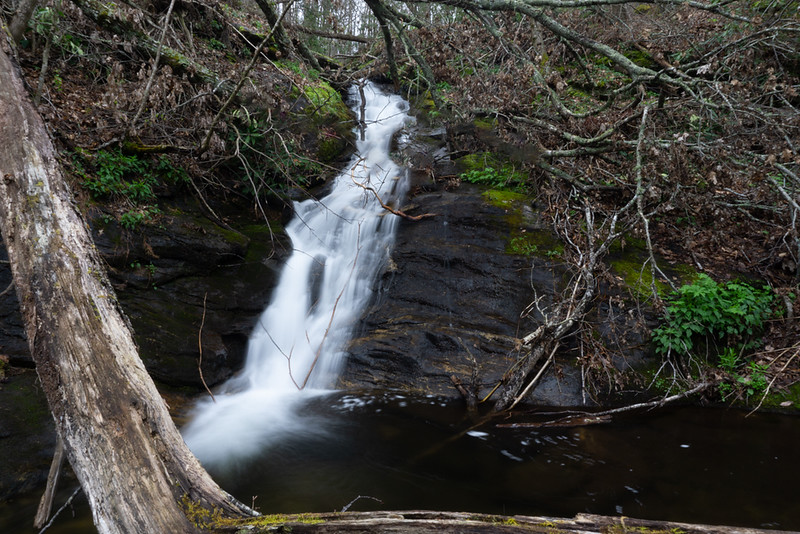 """The first substantial waterfall is a 20 minute hike via a decent """"trail"""".  Located around the 2300 Foot level, this picture shows the bottom 20 feet."""