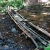 Although there is no trail from here on, hunters, fishers or hikers have built a cleverly designed, low water bridge across the creek.