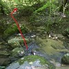 """Stay down at creek level and pick your way down stream on River Left.  The opposite bank gets lower and lower as you approach a tributary.  When the opposite bank looks """"climbable"""", cross the creek and bushwhack up the tributary."""