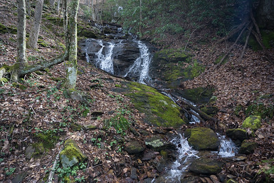 In 1.4 miles ( + or - ), you will arrive at the base of a tall, cascading waterfall.  The very top of the waterfall can barely be seen in this picture.  The top is not as far away (not as high) as this picture makes it look.