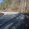 There is a sharp bend in Hwy 129 (Ha! There are many sharp bends in Hwy 129!).  So, to rephrase: at the sharp bend located 5.3 miles north of Turners Corner, beyond the guard rail, there is room enough for a couple of vehicles to pull off the east side of the Hwy .