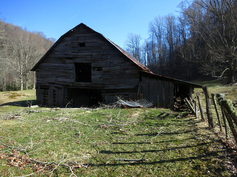 This classic log barn is still used to store hay and provide shelter to farm animals.