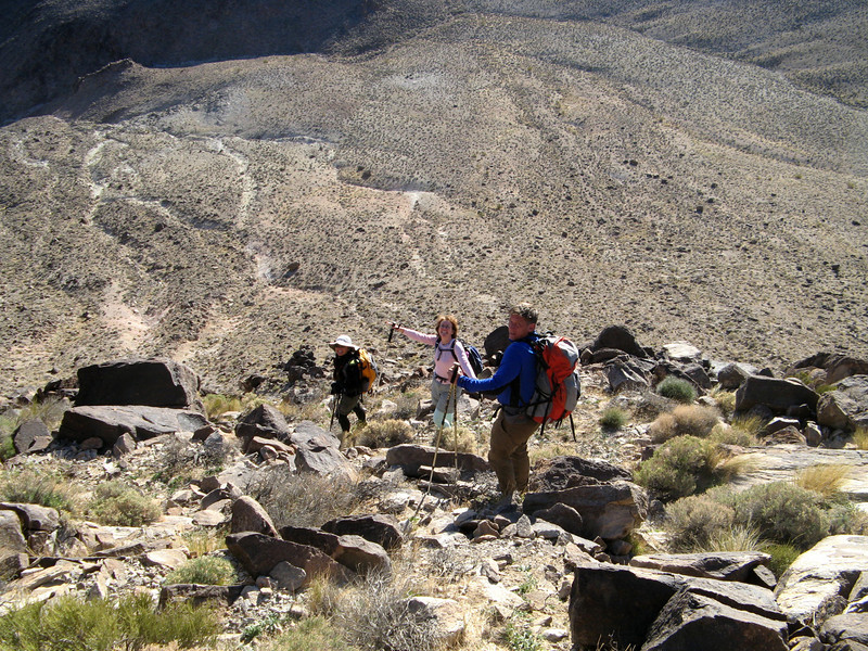 heading down the steep bump