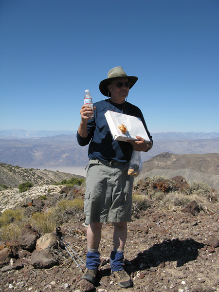 Tom with water and anniversary present on the summit.