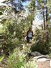 LInda peaking through the bushes.