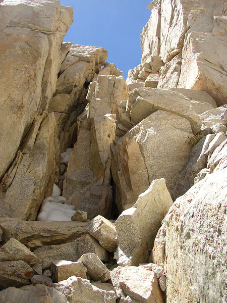 """""""chimney"""" with 40-50 feet of some vertical climbing with very good hand and foot holds to access Russel's East ridge from the South."""