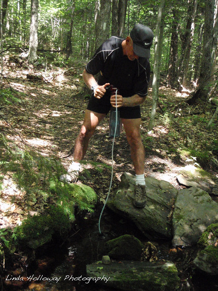 We needed to top off our water supply, so Rob refilled at the first brook.  I was able to wash out my washrags.