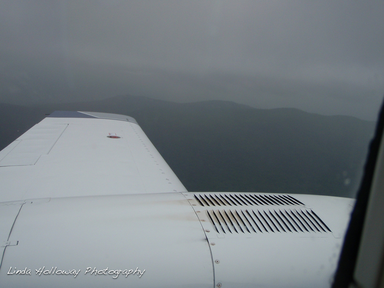 The plane was a little Cessna 8-10 passengers.  I sat right behind the pilot.  We flew through a cloud bank and you couldn't see a thing.  I just prayed no one would run into us or a bird fly into us.  As you can see the mountains were right close.  We arrived in Rutland, Vermont on the afternoon of July 23, 2010.