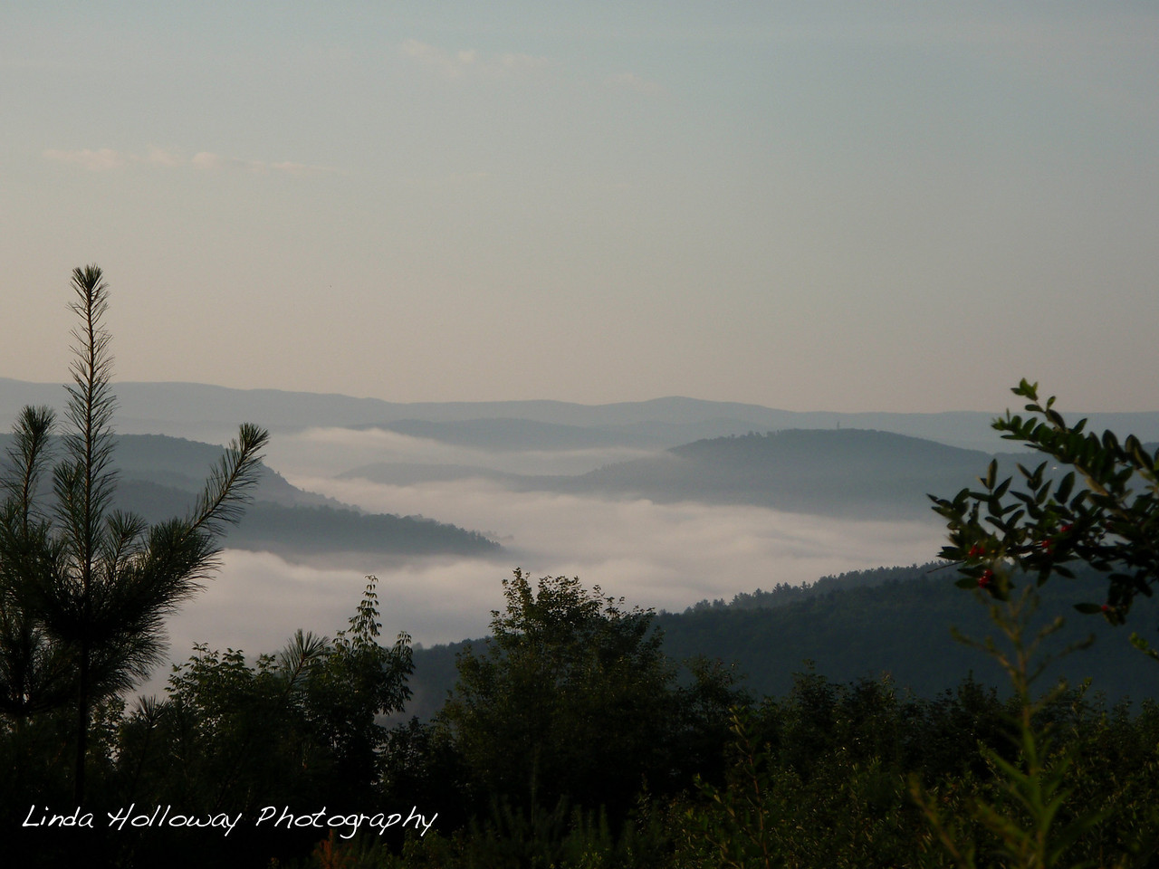 Right when we got on the trail this AM we saw the valley fog around the mountains.  What a sight.