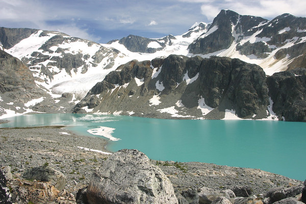 Another shot of the lake and surrounding mountains. Wedge mountain summit is the white point set behind all of the other mountains. Wedge is the tallest mountain in Garibaldi Provincial Park.