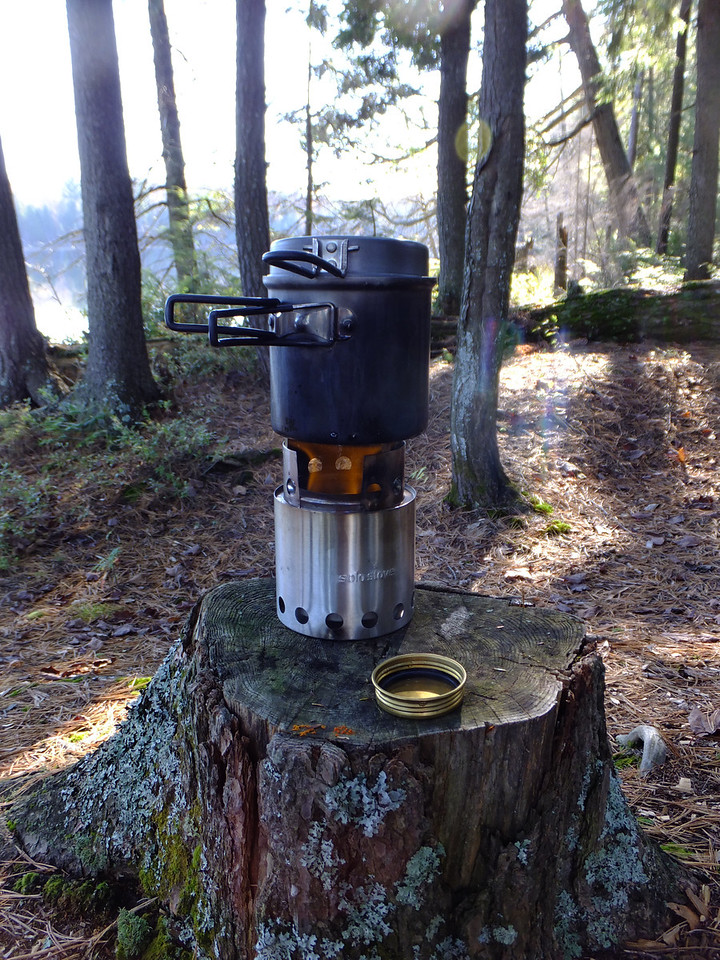 Lunch on Pincher Lake. Trangia alcohol burner fits nicely inside the woodburning stove.