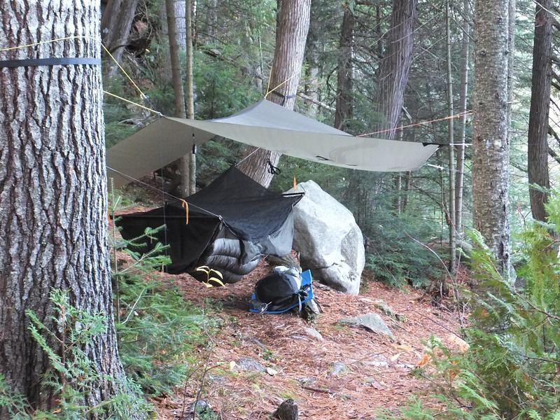 Hammock and tarp at Susan Lake, on the edge of a steep drop to the lake.