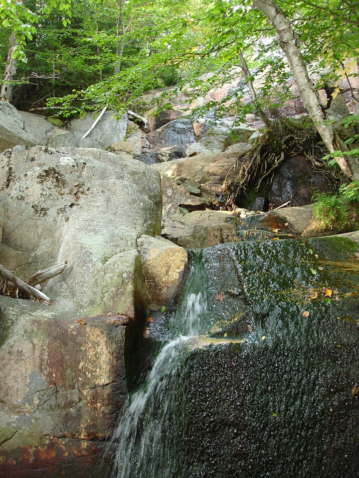 This waterfall is actually part of the trail.  You have to hop across and beside it.
