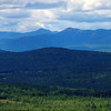 From ledge on Twin Brook Trail, west to Passaconaway and Whiteface, Chocorua and the Three Sisters.