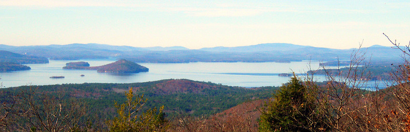 From west summit ledges - Winnepesaukee, with Moosilauke over Red Hill to the right.