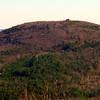 One big house on Mt. Jesse, 2.5 miles SE of south summit ledges,