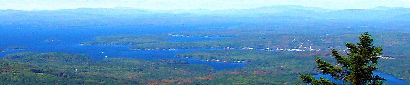 Looking NW from main summit - Wolfeboro up front; Squam Range in L background; Sandwich Mtn. in R.