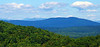 From the Bond summit ledges - NW to Chocorua and the Three Sisters, with Passaconaway behind, to the left.  Mitchell Mtn. in left foreground; Green Mtn. (Effingham, NH) in middle distance.
