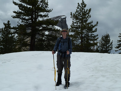 Brent on the snow, top of Half Dome behind.