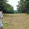 George serenades birthday girl Marlies, on summit of Fox Hill.