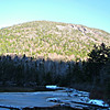 From SW end of Upper Greeley Pond - cliffs on west spur of Kancamagus Mtn.