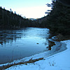 From the beach on the SE edge of Upper Greeley Pond, looking N to one of the Huntingtons,