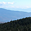 From the Smarts Fire Tower: looking east to Carr Mtn. Sandwich Range in the distance, with Sandwich Dome on the right.