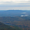 Pleasant Mtn., over Kezar Lake and Pond, from ledges near West Royce summit. Harndon and Pine Hills in middle ground.