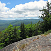 From Middle Mtn. summit ledges:  SSE to Evans Notch, including Speckled Mtn. and the Royces.