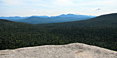 Looking south from Rogers Ledge to Moriah-Carter, Wildcat and Presidential Ranges. Crescent Range in foreground.
