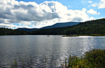 Mt. Wolf and the Kinsmans from the east side of Lonesome Pond.