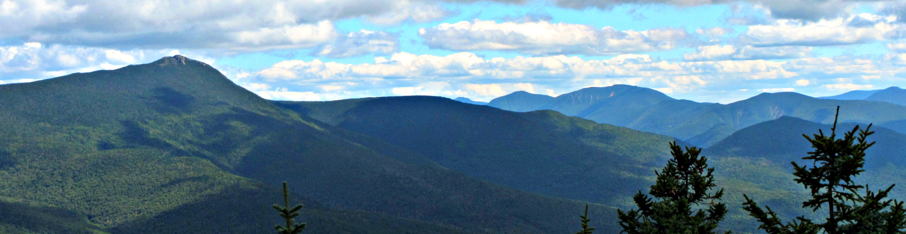 From NE Cannonball: Mt. Flume, a bit of the Tripyramids, the Osceolas and Scar Ridge.
