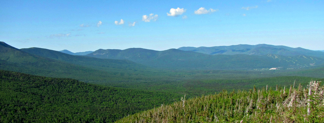 From first viewpoint west.  Bretton Woods ski trails on right; many peaks on left.