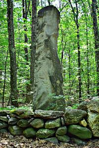 12-foot granite marker at north end of Estabrook Road, in Carlisle just north of Concord.  Word-free Minuteman Memorial or Modern Art?