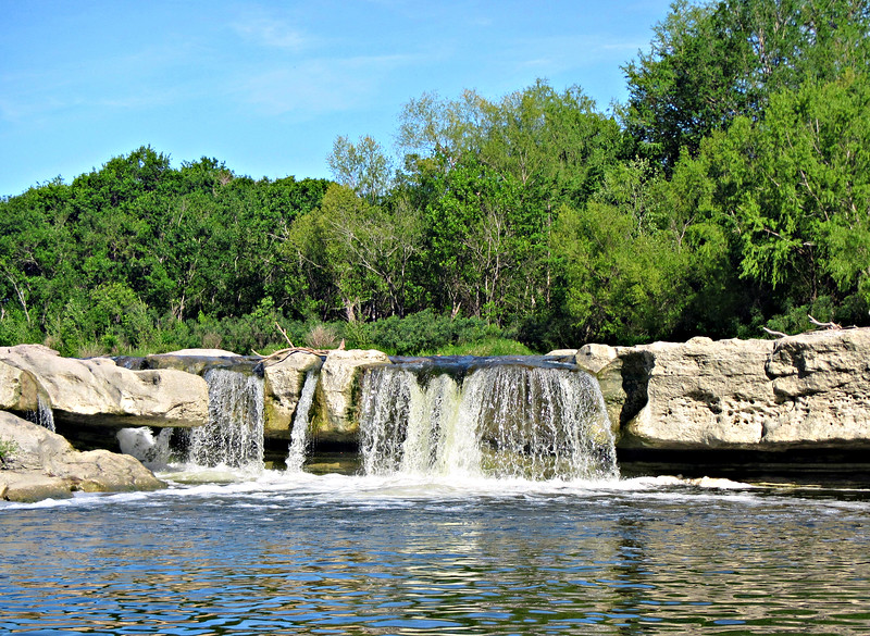 Lower McKinney Falls from the far side of the swimming hole.
