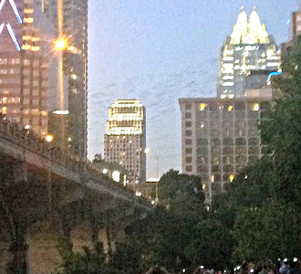 Clouds of bats emerge from Congress Street Bridge