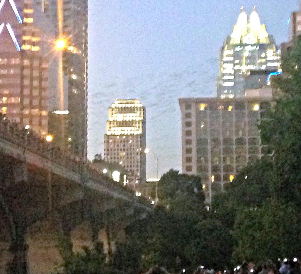 Clouds of bats emerge from Congress Street Bridge