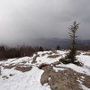The summit and limited views with the clouds and snow coming in.