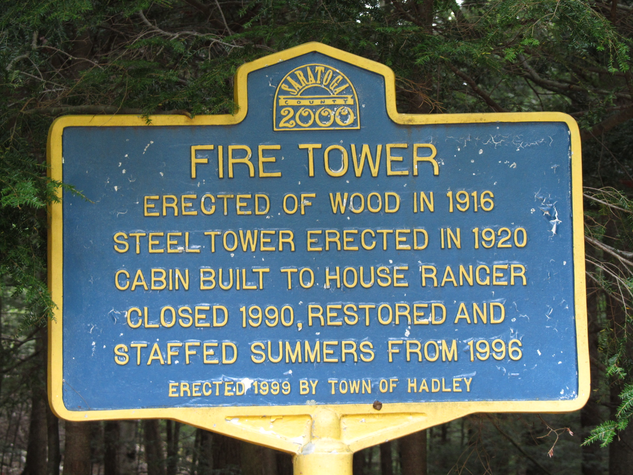The historical sign at the trailhead. Interesting that it was manned up until 1990 even with satellite and planes.
