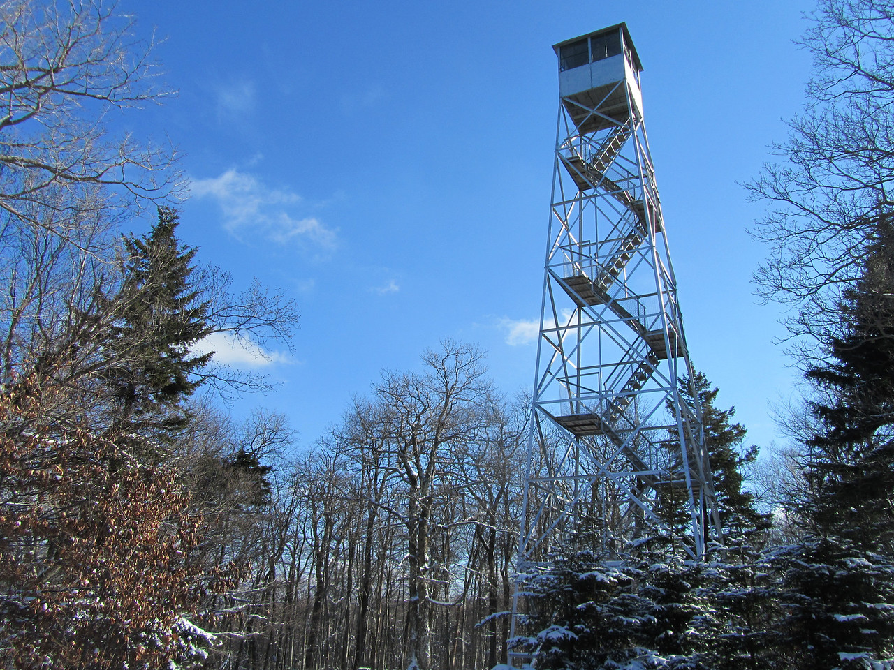 The tower was in great shape: refurbished by volunteers. The stairs were open but the cab of the tower and the ranger cabin locked up. This cabin is manned during the summer with a historian to answer questions. This would make a nice summer hike with picnic and view from the cab of the reservoirs.