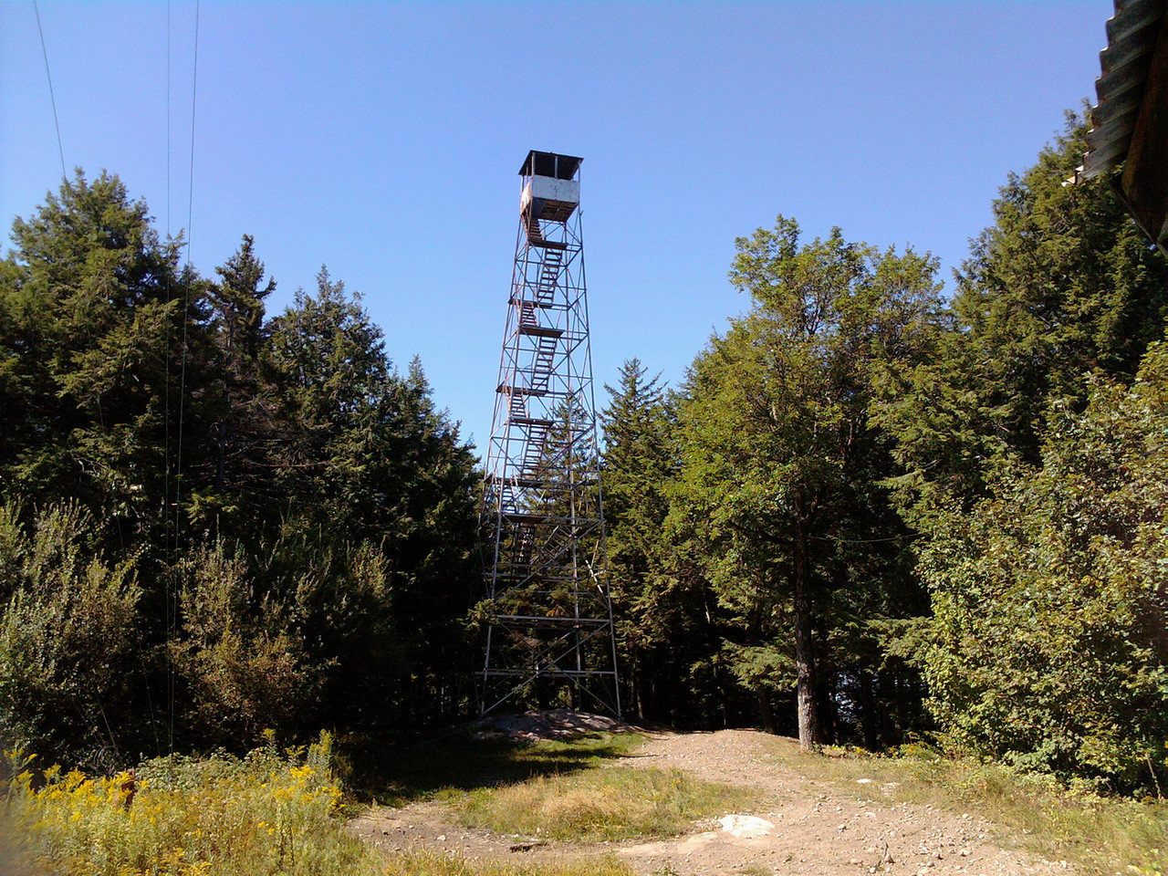 We reached the summit and were sad to see the condition of the place. The old jeep trail was still open so locals ride their quadrunners to the top, have bonfires, break beer bottles all over the place, and shoot holes in the fire tower cab. I had to put the dog on a leash for the first time ever to protect him from stepping on glass.