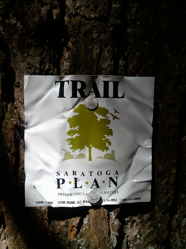 These signs were found sporadically through the woods. There were a few times where you could actually follow them but that was rare. Looked like someone was pulling them down.