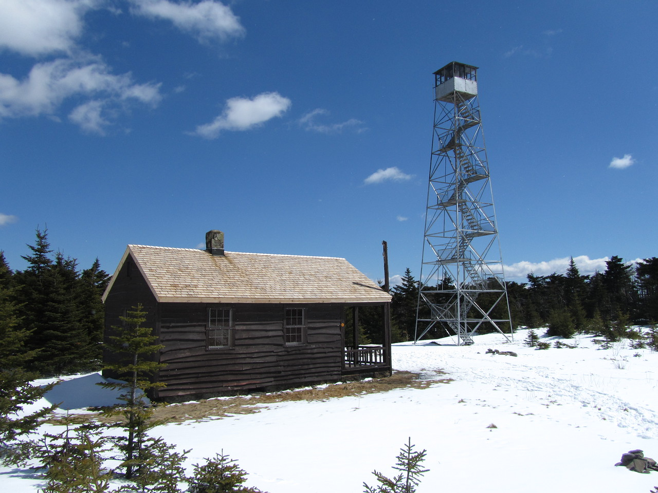 Tower and cabin. Almost looks like a computer model. It is so clear and crisp.